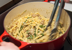 Stirring the cooked pasta