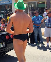 Man in parade with green cowboy  hat