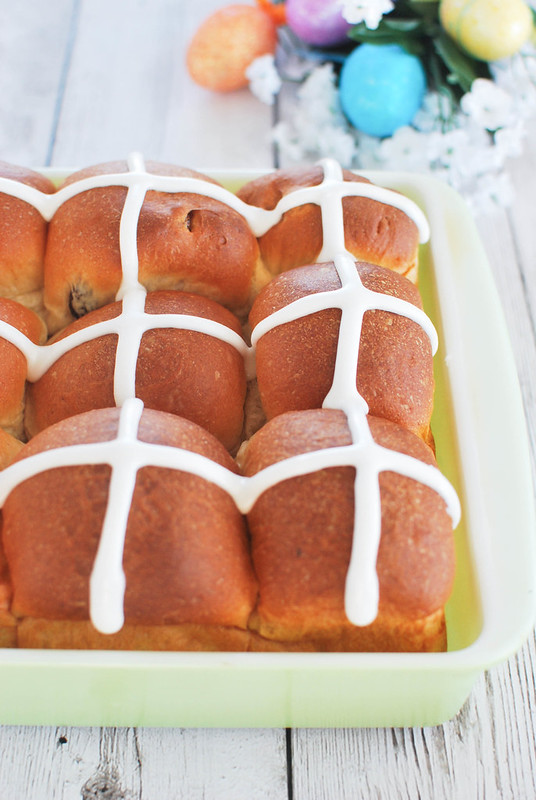Hot Cross Buns - sweet yeast rolls with cinnamon and raisins and topped with icing. Traditional Easter treat.