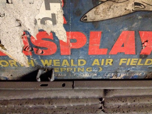 Close up of North Weald Air Display poster in disused passageways at a tube station, London