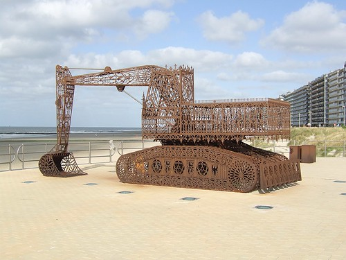 artwork of iron excavator on beach