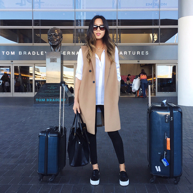 aimee_song_airport_outfit_coat_slipons_michael_kors