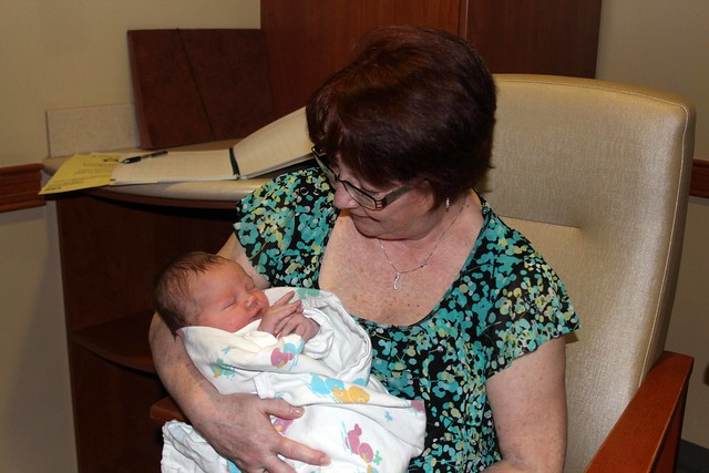 Grandma holding Finnegan for the first time