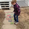 Painting herself some hopscotch with the sidewalk paint the bunny left