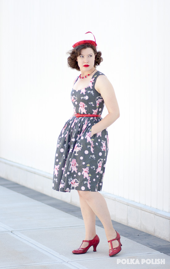 Novelty print drunken pink elephants paired with red accessories is a fun look for a hot summer's day