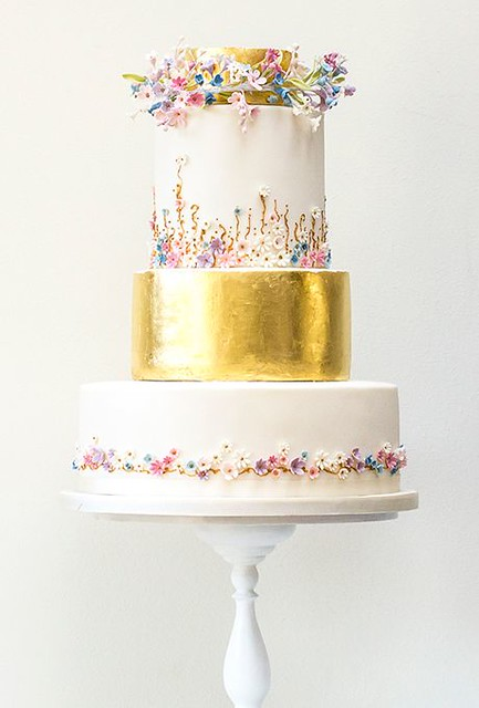 Edible Gold Leaf Cake with Sugar Flowers from brides.com
