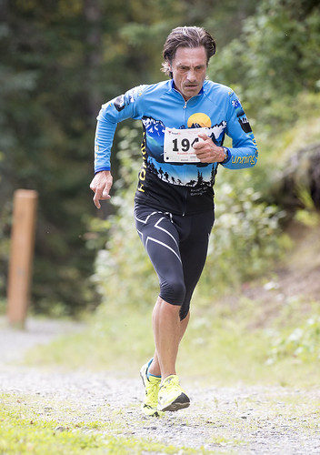 Leonid Isaev come up a trail in Kenai Municipal Park on his way to winning the Superhero 5k.