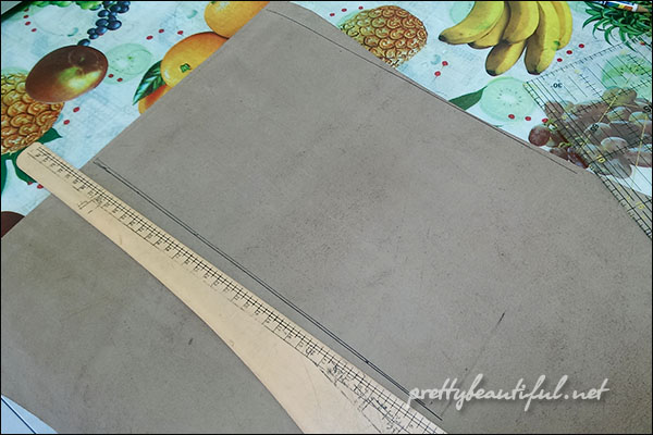 Measuring leather clutch