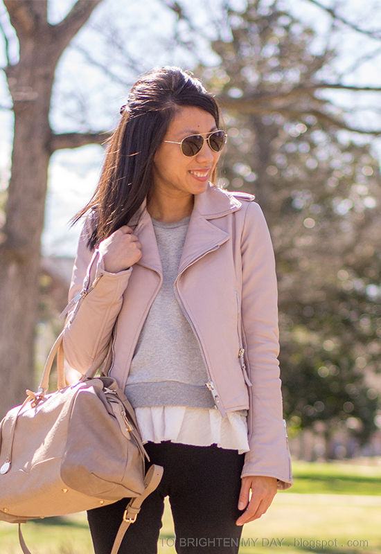 lilac leather jacket, gray ruffled sweatshirt, taupe satchel