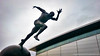 Statue of sprinter outside National Squash Centre Manchester