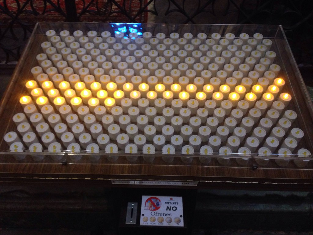 electric offering candles at Barcelona's Cathedral