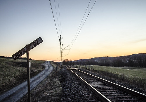 road old railroad sunset sky sunlight sign forest landscape sweden railway swedish wires fields gravel sjuhärad markskommun