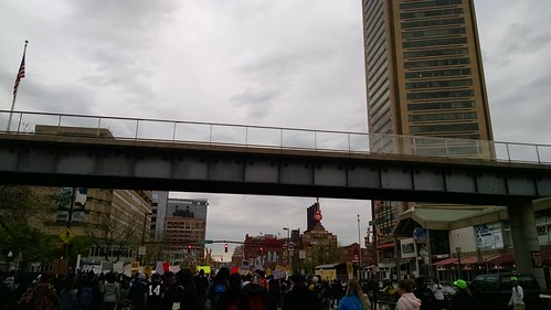 Protesters march past Harborplace and the Inner Harbor.