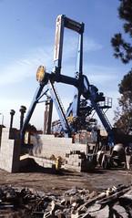 asphalt(0.0), vehicle(0.0), drilling rig(0.0), dredging(0.0), construction equipment(0.0), oil field(0.0), scrap(1.0), demolition(1.0),