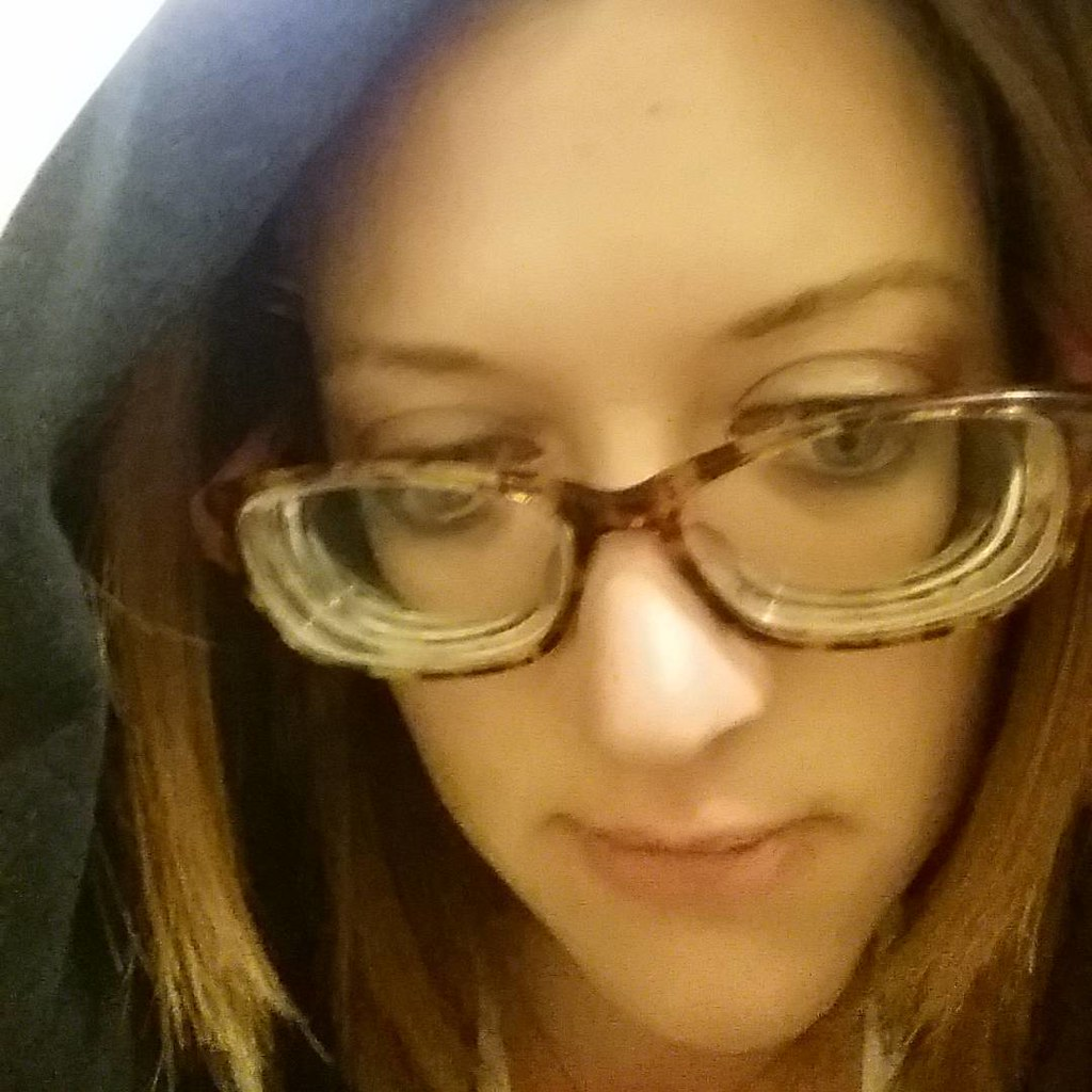 Highly Myopic Brunette Girl With Glasses With Thick Lenses