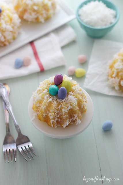 Mini Lemon Coconut Bundt Cakes. A moist lemon cake covered in a vanilla glaze and topped with coconut. They make the perfect little egg nests.