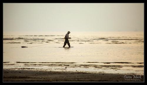 ocean sea gulfofmexico water silhouette sunrise landscape fishing fisherman solitude alone texas shoreline coastal quite seashore bolivarpeninsula galvestontexas gulfshore 2015 bolivarpeninsulatexas canon5dmark3