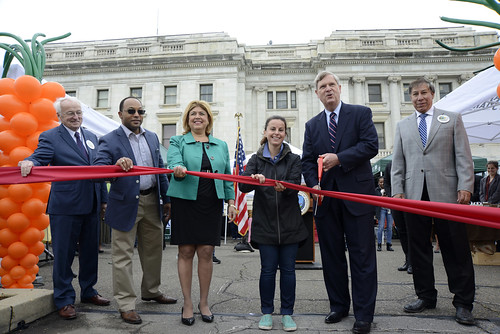 (Left to right)  Under Secretary Kevin Concannon, USDA AMS Deputy Administrator Arthur Neal, Agricultural Market Service (AMS) Administrator Anne Alonzo, USDA Farmers Market Coordinator Annie Ceccarini,  Agriculture Secretary Tom Vilsack, and Under Secretary Ed Avalos cut the ribbon opening at the USDA's 2015 Farmers Market in the east parking lot of USDA in Washington, D.C. on Friday, May 1, 2015. USDA photo by Tom Witham.