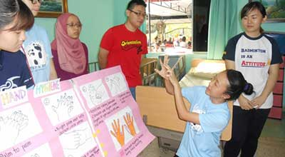 IMU Nursing students and staff trains caregivers at Lovely Nursing Home