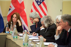 U.S. Secretary of State John Kerry and U.S. Energy Secretary Dr. Ernest Moniz jot down notes on March 30, 2015, in Lausanne, Switzerland, before they and their P5+1 counterparts from Germany, China, the European Union, France, the United Kingdom, and Russia resume strategic conversations about negotiating with Iranian officials over the future of their country's nuclear program. [State Department photo/ Public Domain]