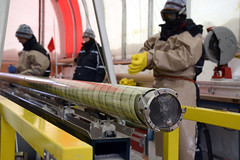 The Ice Drill and Design Operations (IDDO) group at the University of Wisconsin-Madison designed and built the South Pole Ice Core (SPICE) drilling system, called the Intermediate Depth Drill