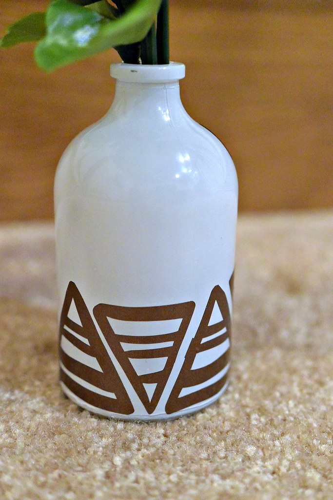 Dress up a simple bud vase with vinyl embellishments