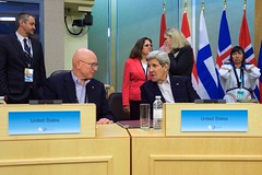 U.S. Secretary of State John Kerry speaks with U.S. Special Representative for the Arctic Retired Coast Guard Admiral Robert Papp amid meetings of the Arctic Council in Iqaluit, Canada, just below the Arctic Circle, on April 24, 2015. [State Department Photo/Public Domain]