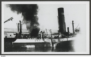 """City of Singapore"" on fire at No.2 Dock, Port Adelaide. - Photograph courtesy of the State Library of South Australia"