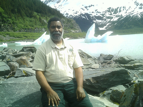 Robert Stovall is a deputy district ranger on the Chugach National Forest. Here, he takes a moment to rest at Portage Glacier Lake near the Forest Service's Begich Boggs Visitor Center on the forest's Glacier Ranger District. (U.S. Forest Service photo)