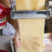 Rolling out sheets of fresh pasta with KitchenAid pasta roller