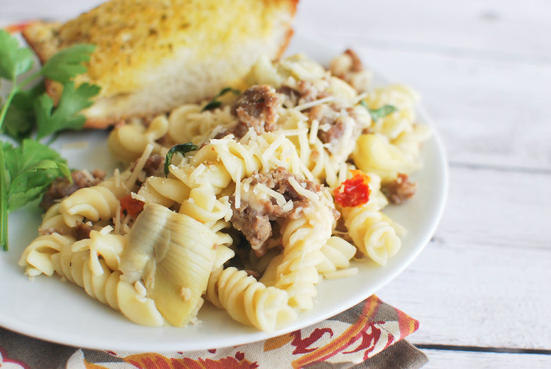 Pasta with Sausage, Artichokes, and Sun-Dried Tomatoes - a light pasta recipe that won't weigh you down.