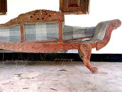 Damaged wooden sofa