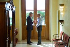 U.S. Secretary of State John Kerry chats in a hotel hallway with James Timbie, Senior Adviser to the Under Secretary of State for Arms Control and International Security, amid a break in Iranian nuclear program negotiations on March 30, 2015, in Lausanne, Switzerland. [State Department Photo / Public Domain]