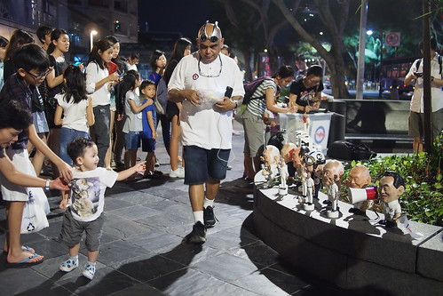 Christopher Pereira (Chris Treewizard) and his LKY dolls and figurines,  past the long queues to pay last respects to Lee Kuan Yew lying in state at Parliament House, Singapore