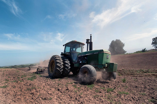 A tractor turns the cover crop into the soil in preparation for planting at Leafy Greens, a farm in the Salinas Valley of California. USDA Photo by Lance Cheung.