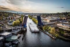 Final SR 520 floating bridge pontoon passing by Seattle's Fremont neighborhood.