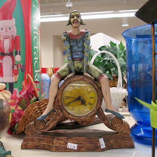 clown straddling clock