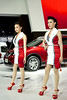 Sexy Nissan presenters with X-Trail in the back at the 36th Bangkok International Motor Show