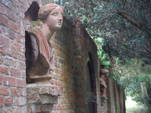Busts on Wall along Path by Walled Garden, Lilies, Weedon (close-up)