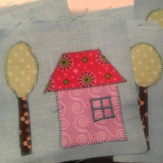 Applique done. now fitting in 12 teeny tiny doors
