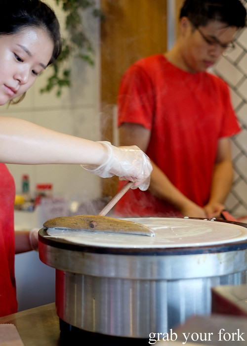Spreading the jianbing pancake batter at Mr Bing, Chippendale