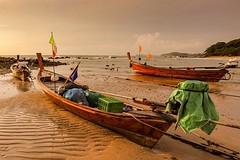 Longtail boats at low tide on the peaceful beaches of Koh Lanta, Thailand #travel #amazingthailand #island