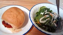 Chicken Parmesan Sandwich With Spinach Salad.