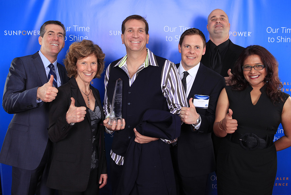 Positive Energy Solar accepts award at the 2015 SunPower Dealer Conference. Positive Energy Solar staff members shown: Regina Wheeler, CEO (second from left); Taylor Selby, Vice President (third from left); Karen Paramanandam, Marketing Director (far right).