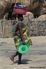 Woman with baby and laundry, Senga Bay, Malawi