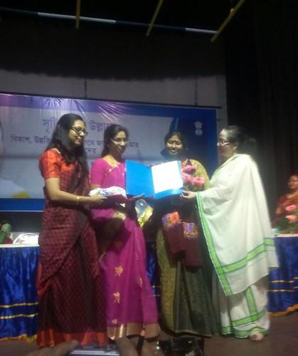 Rahima Khatun taking award of `Rajya Mahila Samman-2014' from Shashi Panja, Minister of State department of Women and Child Development of Government of West Bengal.