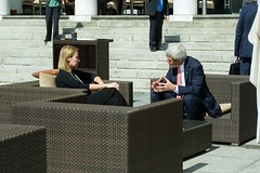 U.S. Secretary of State John Kerry chats on a hotel terrace with European Union High Representative for Foreign Affairs Federica Mogherini amid a break in Iranian nuclear program negotiations on March 30, 2015, in Lausanne, Switzerland. [State Department Photo / Public Domain]