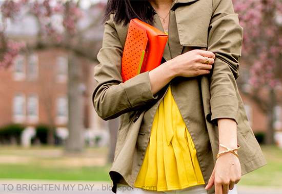 green swing jacket, mustard pleated top, orange clutch