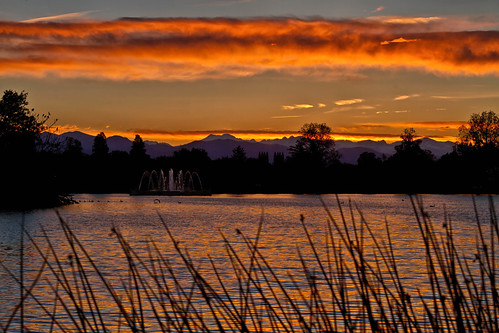 sunset sky orange lake fountain clouds landscape rockies geese colorado denver rockymountains citypark