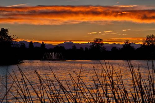 sunset sky orange lake fountain clouds landscape rockies geese colorado denver rockymountains citypark